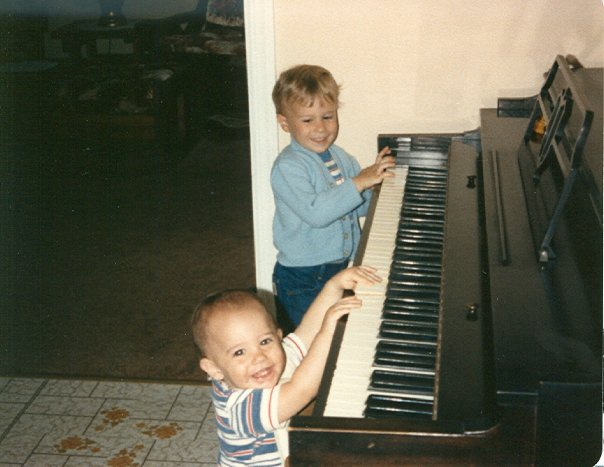 carrozzo brothers playing on piano as toddlers
